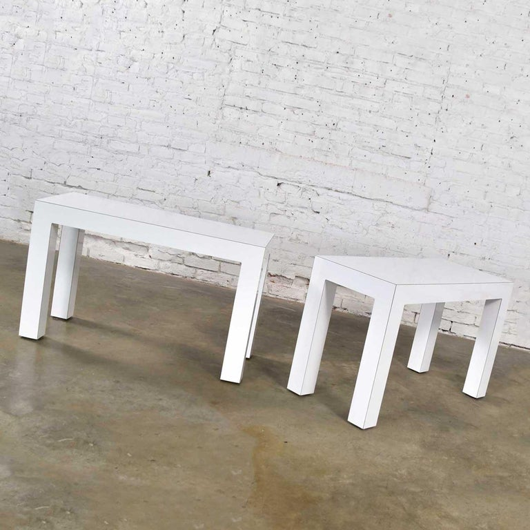 Awesome pair of rectangular shaped white laminate covered particle board parson's style side or end tables with optional rectangle glass tops. Wonderful vintage condition. Minor dents on one leg have been touched up and there is a chip in 1 corner