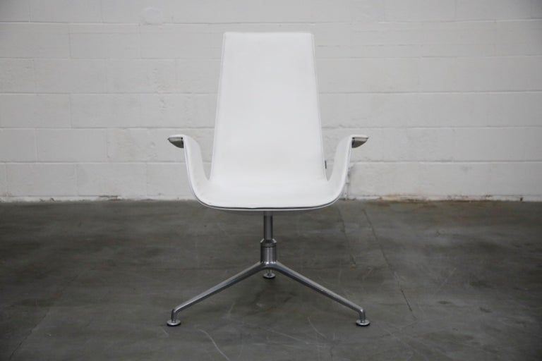 High-back swivel example of the extremely popular-amongst-designers and collectors, white leather 'Bird' chair model # FK-6727, also commonly referred to as the 'Tulip' bucket chair, designed by Preben Fabricius and Jørgen Kastholm, manufactured in