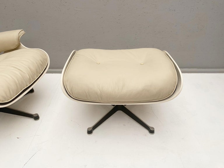 White lounge chair and ottoman in style of Charles and Ray Eames- A pair available.