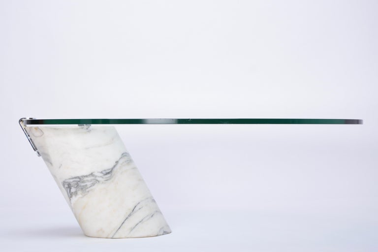 White Marble and Glass Coffee Table Model K1000 by Team Form for Ronald Schmitt  Coffee table designed by Team Form for Ronald Schmitt in the 1970s. The base of this table is made from solid marble. The thick oval glass top lays loose on the marble
