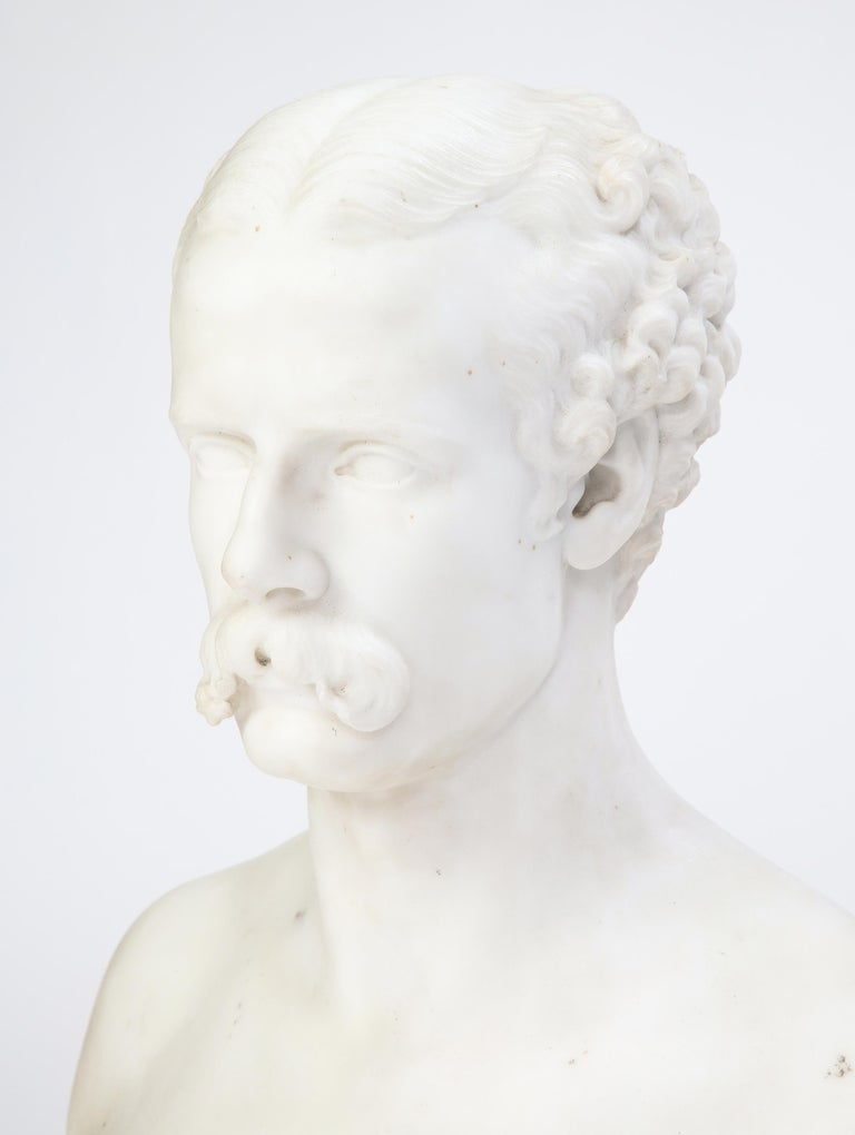 This work, a Baroque style carved white marble bust of a man with Classical features raised on a decorative turned plinth, is an excellent example of an artwork probably carved in Italy during the explosion of decorative sculpture in the 19th and