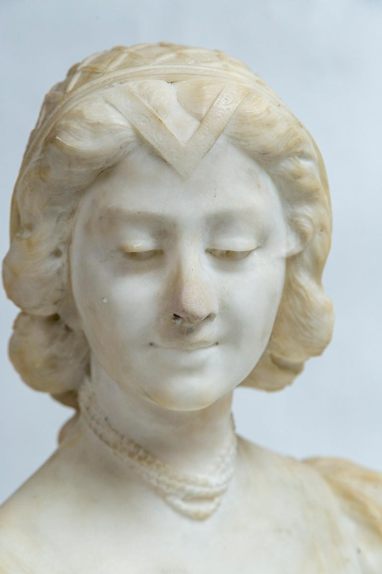 Hand-Carved White Marble Bust of a Young Woman For Sale