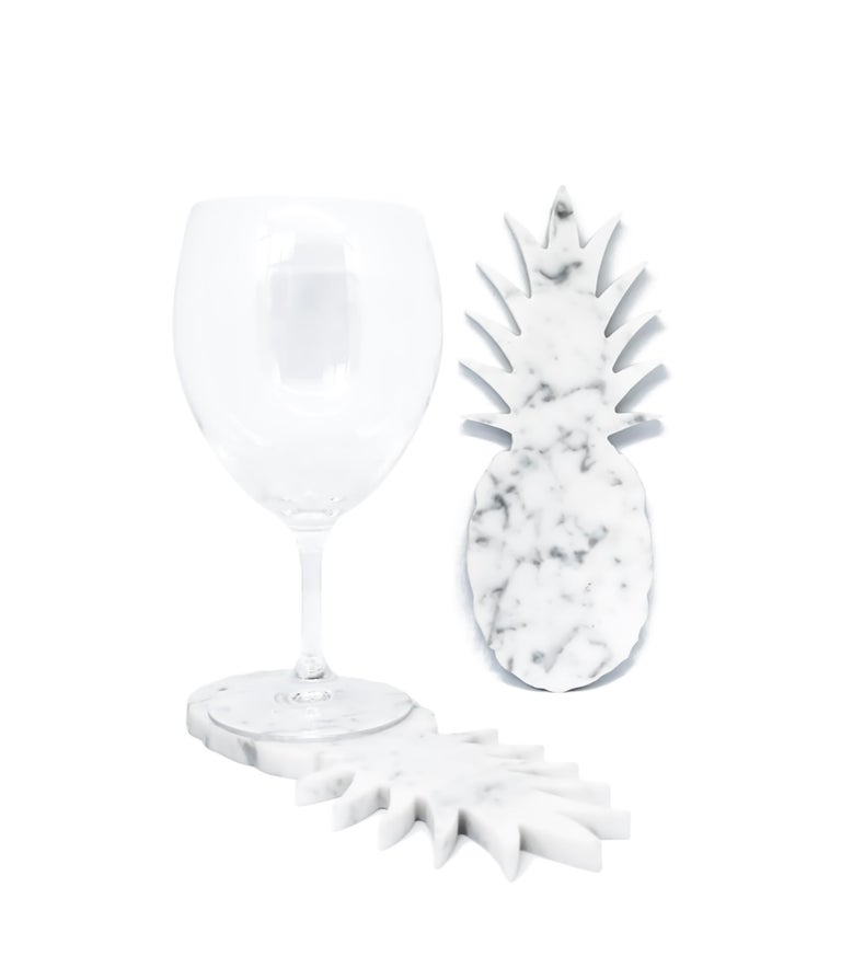 White Carrara marble coaster with pineapple shape. Each piece is in a way unique (every marble block is different in veins and shades) and handmade by Italian artisans specialized over generations in processing marble. Slight variations in shape,