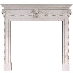 White Marble Fireplace with Carved Lion's Mask