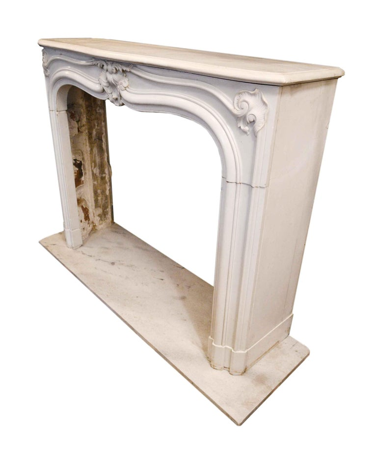 """This mantel is made of lovely white marble and features winding floral design accents throughout. The fine craftsmanship of this mantel would bring great character to any space!  Dimensions:  Mantel: 15.5"""" deep x 53"""" wide x 42"""" tall  Mantel"""