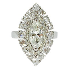 White Marquise, Round Brilliant and Round Rose Cut Diamond Ring in 18 Karat Gold