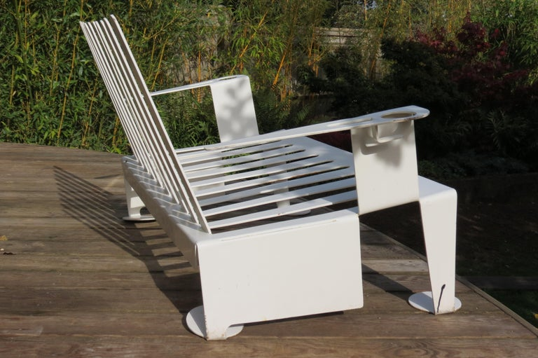 White metal moden design bench, 1990s A very good quality metal bench from the 1990s, good quality thick steel. Very cleverly cut and formed from one sheet of metal. Possibly a prototype. Good over all condition, some wear and minor loss to the