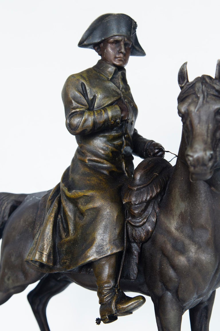 With his right hand, typically tucked into his coat, the Emperor wears a hat and long coat. He sits proudly upon his steed. Below the horse is a cannon trophy on an integral rocky base, the back side stamped FRANCE. Unsigned.