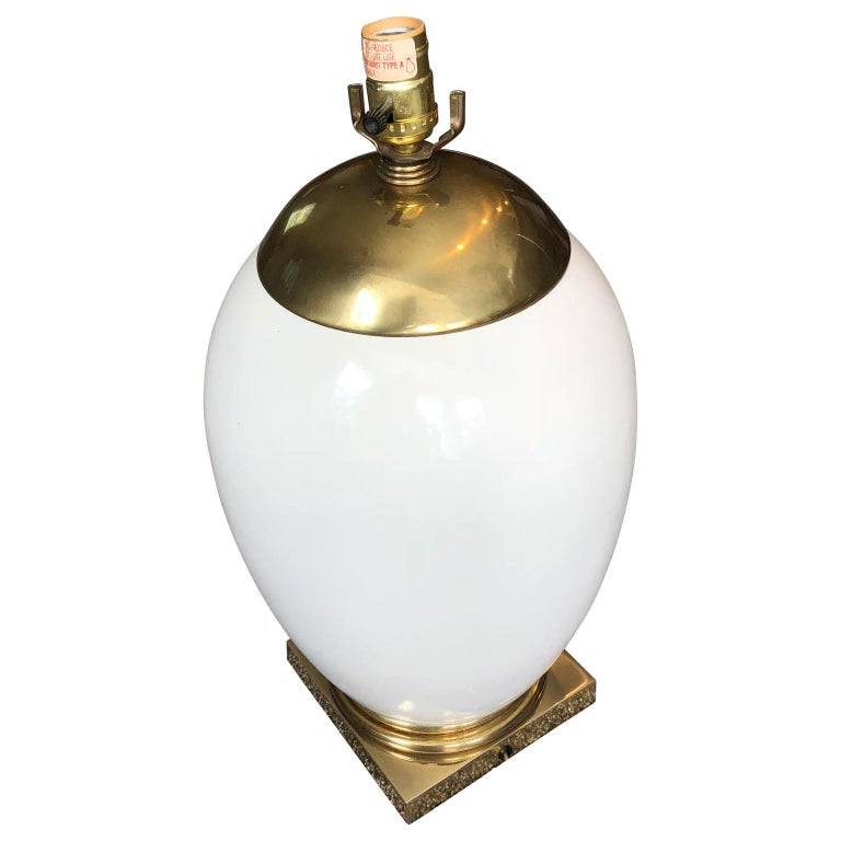 Mid-Century Modern Ellipse shaped enamel and brass table lamp. Lamp is newly re-wired.