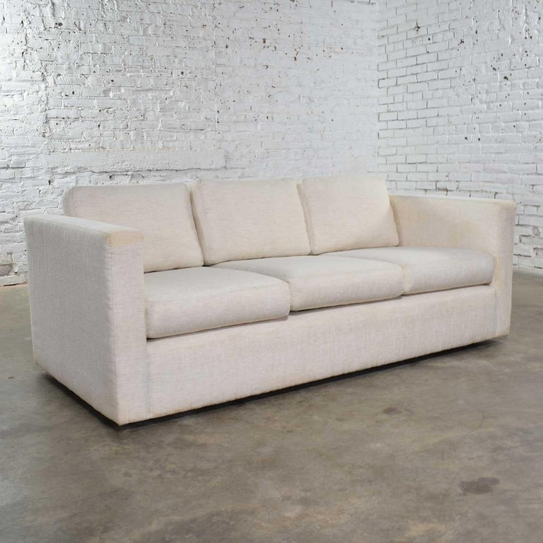 Handsome modern tuxedo style sofa designed by Milo Baughman for Thayer Coggin. This is from an unspecified collection from the 1980s. It is in good vintage condition. The structure is solid but even though we have had it professionally cleaned it