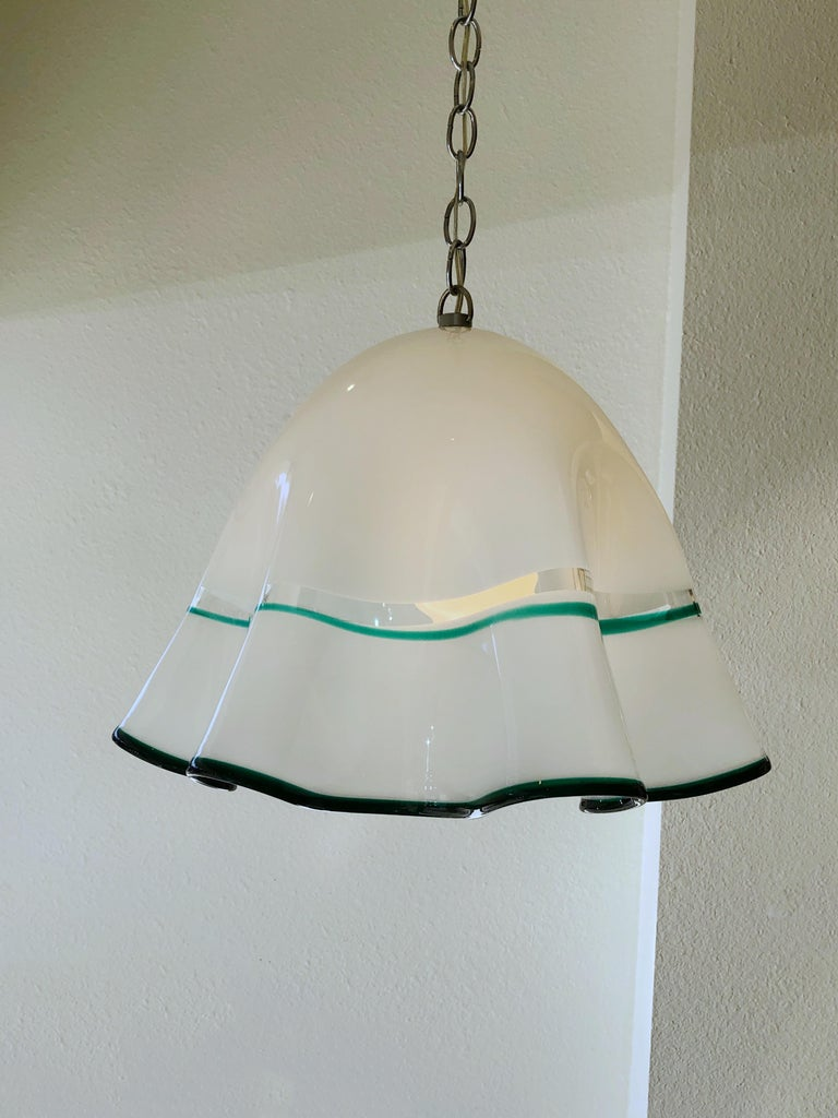 """A 1960s Italian white with forest green outline Murano glass and chrome chain """"Fazzoletto"""" by Mazzega. Newly rewired. We can add more chain if need. Dimensions: 19"""" diameter, 15"""" high, 48"""" high with chain."""