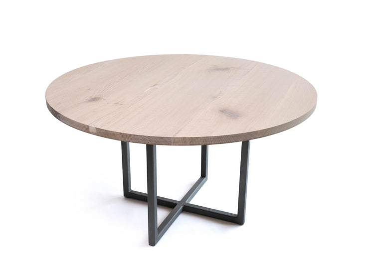 The white oak round table by Alabama Sawyer unifies the family for a meal or any occasion. Gather around and catch up with relatives. Plan a family vacation. Carve a turkey. Pewter accents show off the uniqueness of the grain. A variation of our