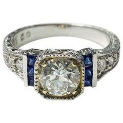 White Old European Cut Diamond and Blue Sapphire Ring in 18 Karat Gold
