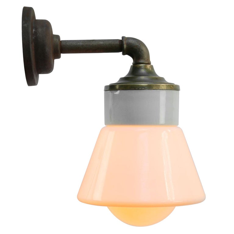 Porcelain industrial wall lamp. White porcelain, brass and cast iron White Opaline glass. 2 conductors, no ground.  Diameter cast iron wall piece 10 cm. 2 holes to secure.  Weight: 2.30 kg / 5.1 lb  Priced per individual item. All lamps