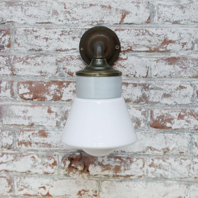 20th Century White Opaline Glass Brass Vintage Cast Iron Arm Scones Wall Lights For Sale