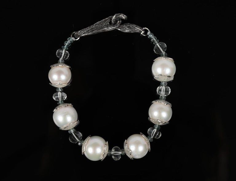 Beautiful, 11mm freshwater pearls are embraced by White Orchid Studio's handcrafted and textured sterling spacers.  Carved prasiolite and faceted apatite add to the beauty of a bracelet finished with White Orchid Studio's signature vanilla bean