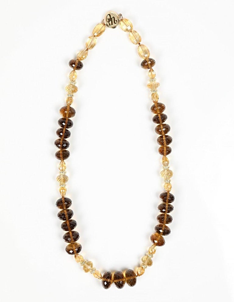 Lavish whiskey quartz (11 to 14mm) embraces three sizes and shapes of faceted citrine to create an opulent princess length necklace. Complementary colors of the gems are warmed further by 14kt yellow gold spacers and finished by White Orchid