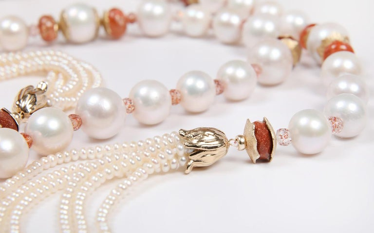 Large (12 to 16mm), off-round, creamy white freshwater pearls are cloaked by opaque and translucent sunstone, goldstone and our White Orchid Studio spacers in 14kt yellow gold.  This sartoir ends with our 14kt yellow gold, handcrafted bead caps that