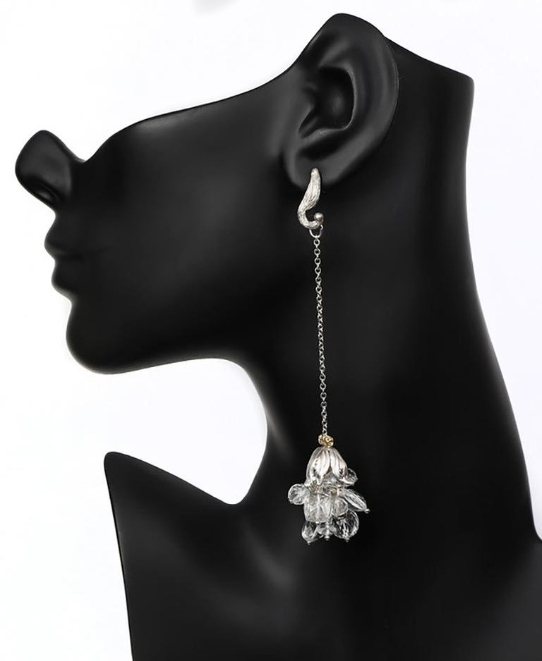White Orchid Studio swings a riot of silver and clear crystal quartz from our signature vanilla bean earrings and silver chain, our signature silver bead cap and a crown of woven 14kt yellow gold.