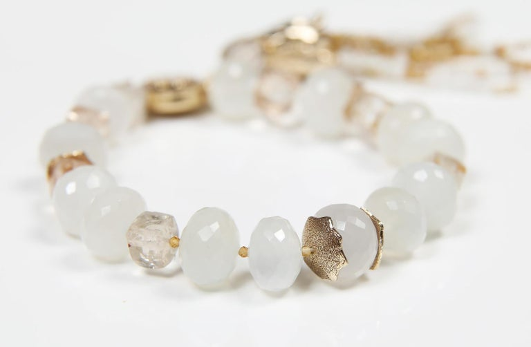 The beauty of faceted precious topaz and white moonstone are accentuated by White Orchid Studio's handcrafted, 14kt yellow gold spacers and logo clasp.  A tassel of moonstone and topaz, with White Orchid Studio's 14kt yellow gold bead cap,