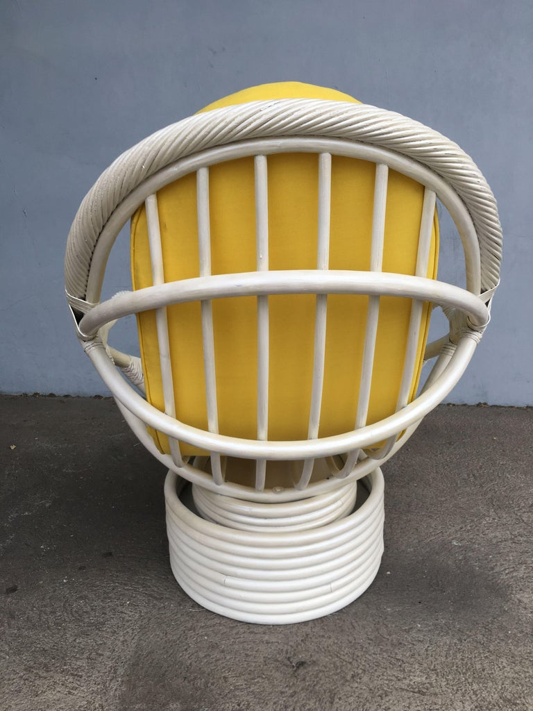 Late 20th Century White Painted Rattan Bucket Lounge Chair with Swivel Base For Sale