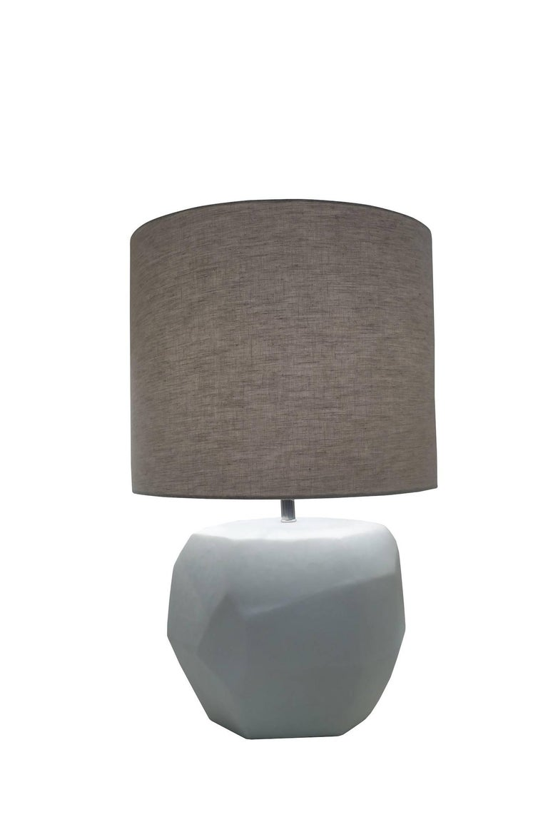 Contemporary Romanian matte white pair of lamps with cubist decorative shape. Linen shade. Newly wired. Measures: Overall height with shade 25.5