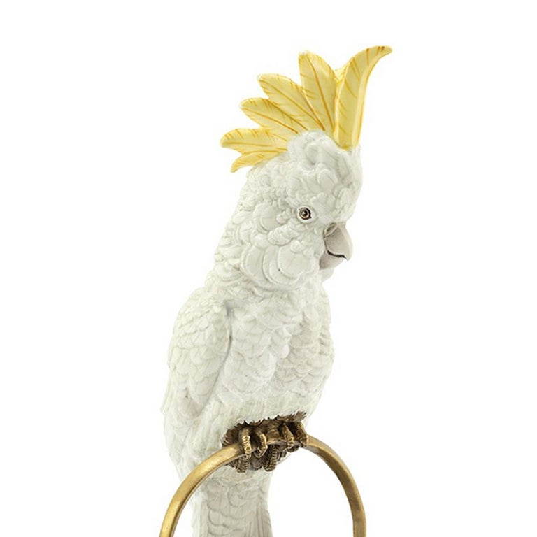 Sculpture white parrot on ring in hand painted white porcelain with brass details.