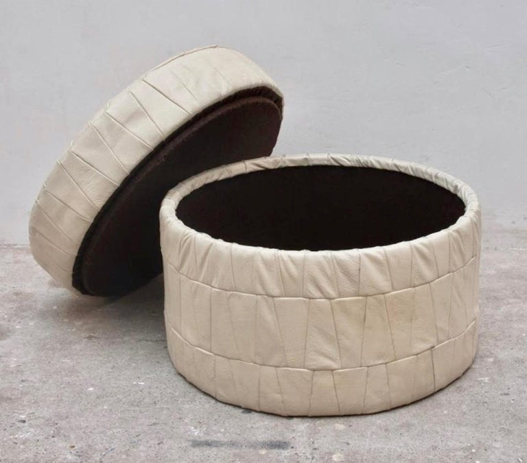 Patchwork leather ottoman by De Sede in white. Ottoman has storage inside. Good condition. Great accent piece and nice scale.  Multiple De Sede leather ottomans available in our other listings.