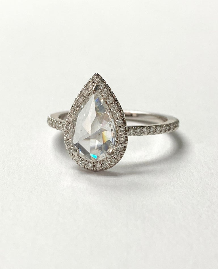 This gorgeous white pear shape rose cut diamond engagement ring is beautifully handmade in 18k white gold.  The details are as follows :  Pear shape rose cut diamond weight : 1.03 carat ( F color and SI1 clarity )  Diamond weight : 0.30 carat  Metal