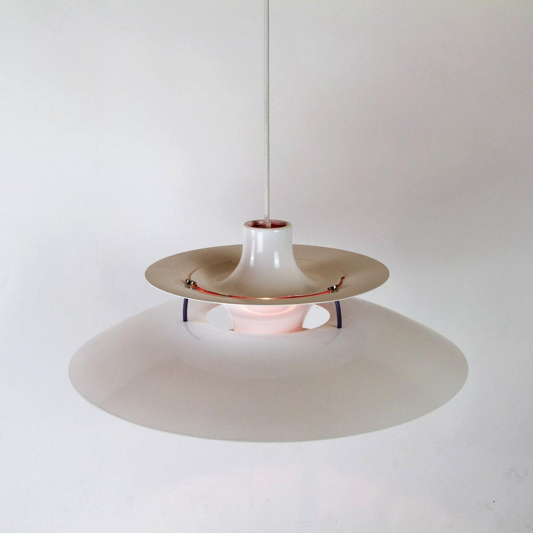 A restored and resprayed white PH5 ceiling light designed by Poul Henningsen for Louis Poulsen. Designed in 1958 the PH5 is one of the most elegant and iconic pendant lights to come out of Denmark. The layered shades have been designed to hide the