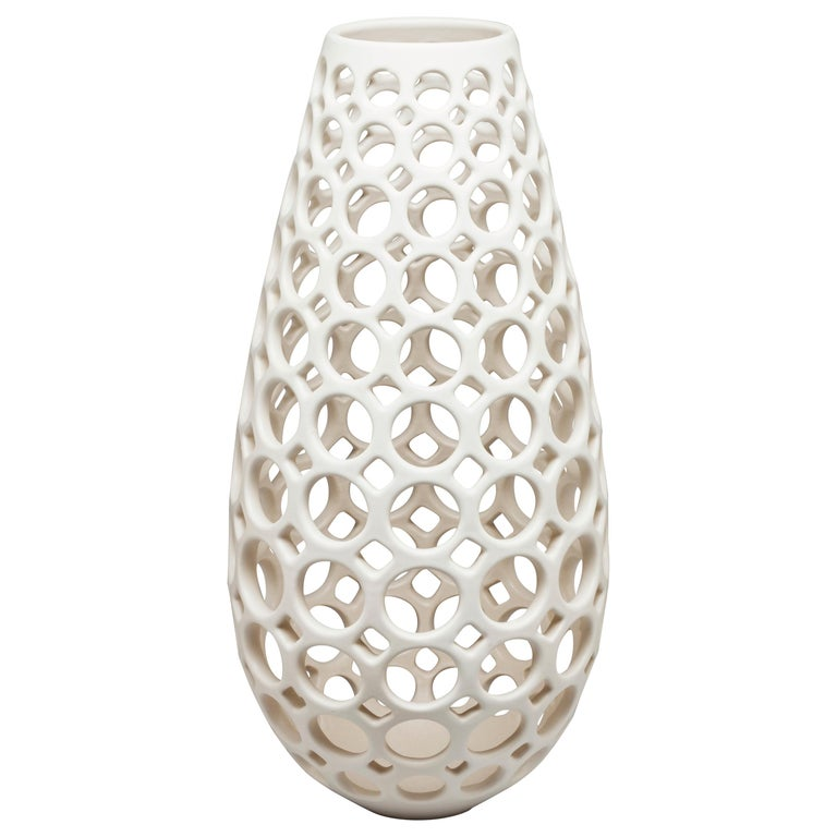 White Pierced Elongated Teardrop Shaped Tabletop Sculpture/ Candleholder For Sale