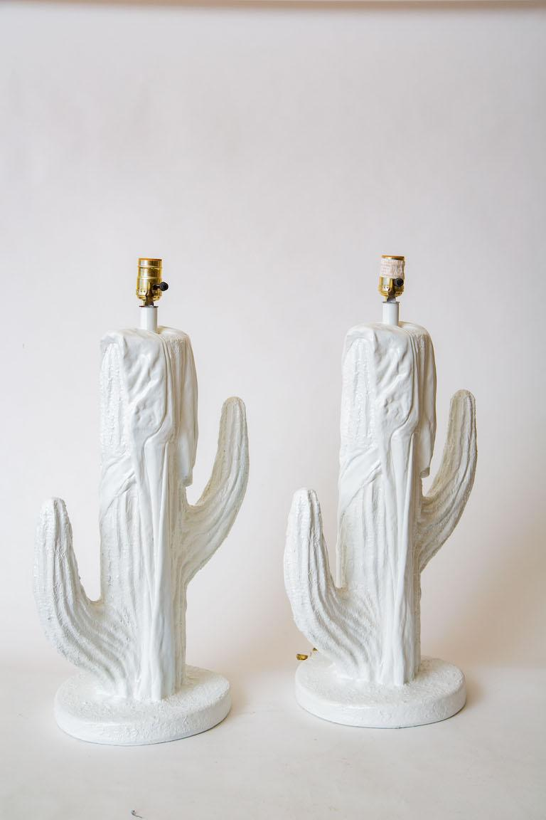 These chic pair of white vintage Plaster of Paris are cactus forms. They are from the 1970s and have been newly re-painted to make them fresh. As of the photography shooting they were not re-wired but will be before purchase. The measurement to the