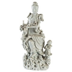 White Porcelain Statuette of a Divinity and His Child