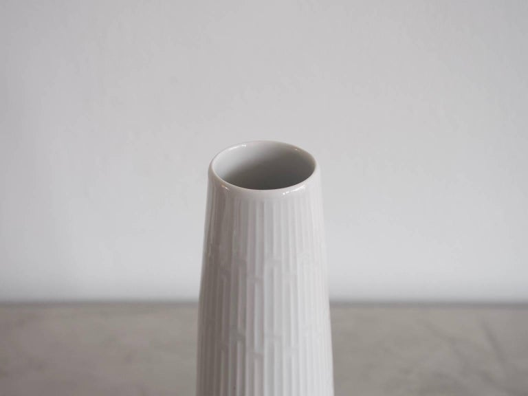 Beautiful large white porcelain vase with a relief finish. Manufactured and marked by Meissen Porcelain.