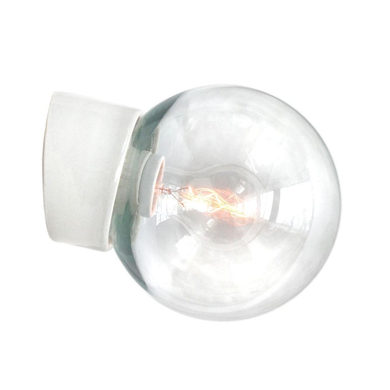 Industrial ceiling lamp. White porcelain, clear glass.  2 conductors, no ground. Measures: Diameter foot 10 cm Suitable for 110 volt USA new wiring is CE certified (220 volt) or UL Listed (110 volt)   Weight: 1.1 kg / 2.4 lb  Priced per