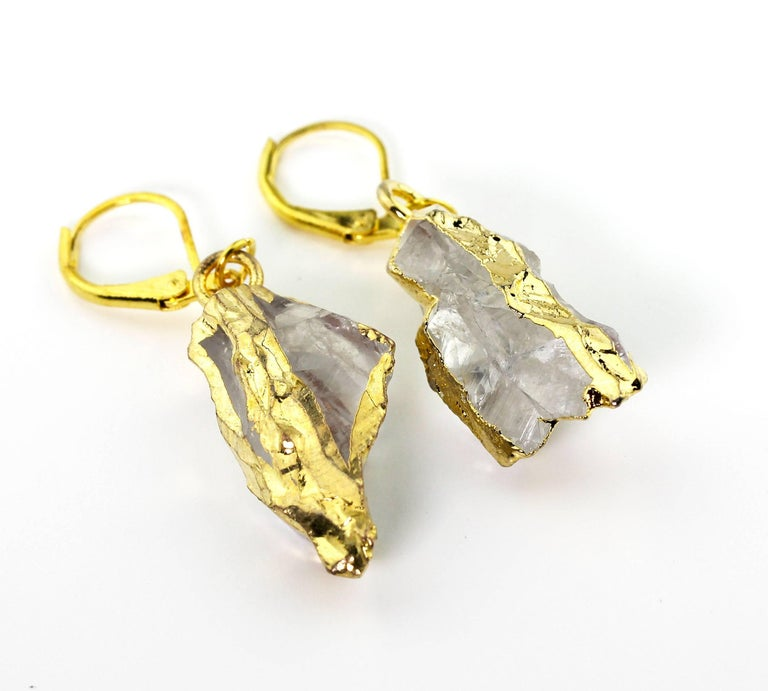 Bright translucent natural White Quartz rock dangling gold plated lever-back earrings.  They hang approximately 2 inches long.