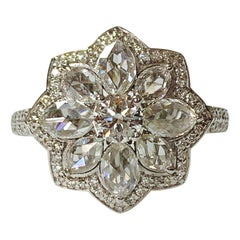 White Round Brilliant and Rose Cut Diamond Engagement Ring in 18 Karat Gold