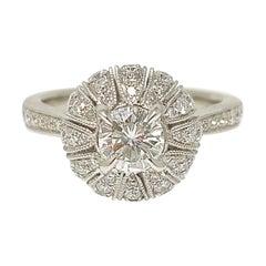 White Round Brilliant Cut Diamond Engagement Ring in 18 Karat White Gold