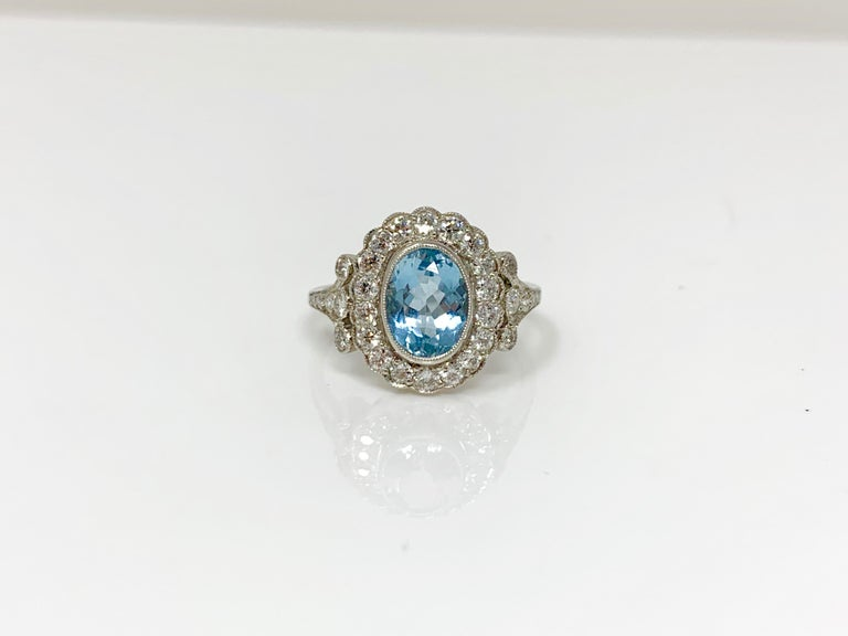 This gorgeous ring features aquamarine and white round brilliant diamond and is hand crafted in platinum.  Aquamarine weight - 1.90 carat  white diamond weight - 1.20 carat ( GH color and VS clarity)  Metal - Platinum  Ring Size - 7 1/2 ( can be