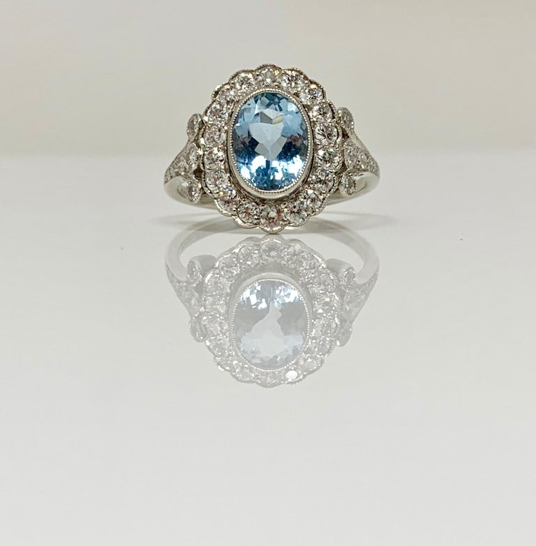 White Round Brilliant Diamond and Aquamarine Ring in Platinum In New Condition For Sale In New York, NY