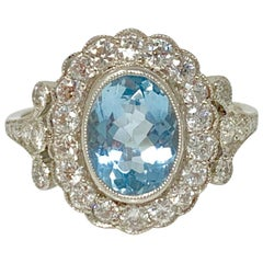 White Round Brilliant Diamond and Aquamarine Ring in Platinum