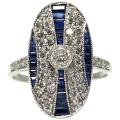 White Round Brilliant Diamond and Blue Sapphire Ring in Platinum