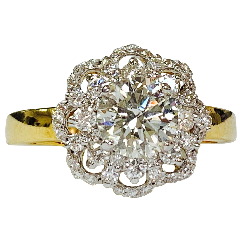 White Round Brilliant Diamond Engagement Ring in 18 Karat Yellow Gold