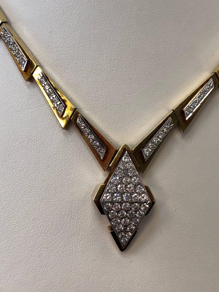 2.50 carats of white diamond rounds in this unique design.  This necklace is in 14k yellow gold and 18