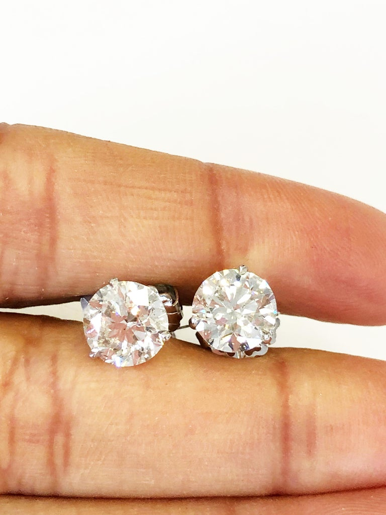 Classic white diamond rounds weighing a total weight of 4.10 carats.  White, eye clean, and bright.  The stones are 2.00 carats and 2.10 carats each.  Set in a handmade 14k gold mounting.  Big look for a reasonable price.  Great for everyday or