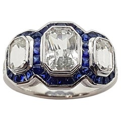 White Sapphire with Blue Sapphire and Diamond Ring Set in 18 Karat White Gold