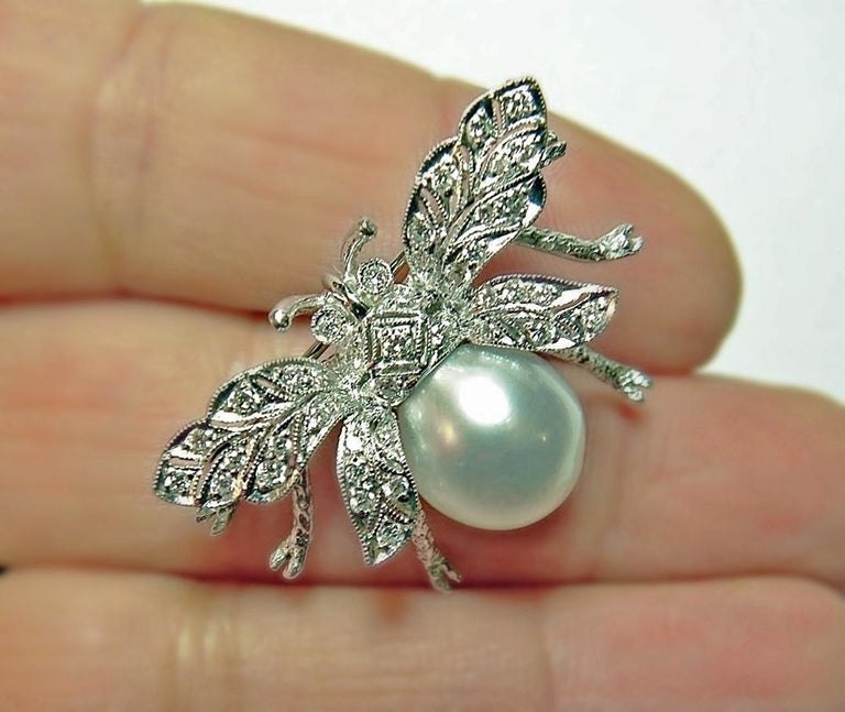 White South Sea Pearl Diamond White Gold Bumble Bee Brooch Pin Broche 18K  Primary Stone: Natural Diamond & South Sea White Cultured Pearl Shape or Cut Diamond: Round Cut  Diamond Weight: Approx. 0.50 Carats  Measurements Pearl: 12.30mm Enhancement: