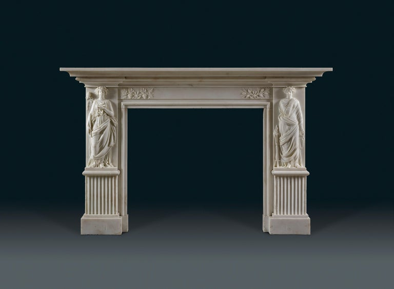Each jamb bears carved figures of classical Bacchic maidens, one carrying the wine cup, symbolizing revelry and intoxication, the other is accompanied by a burning torch, symbolizing Bacchic fertility and virility. The frieze carved with details in