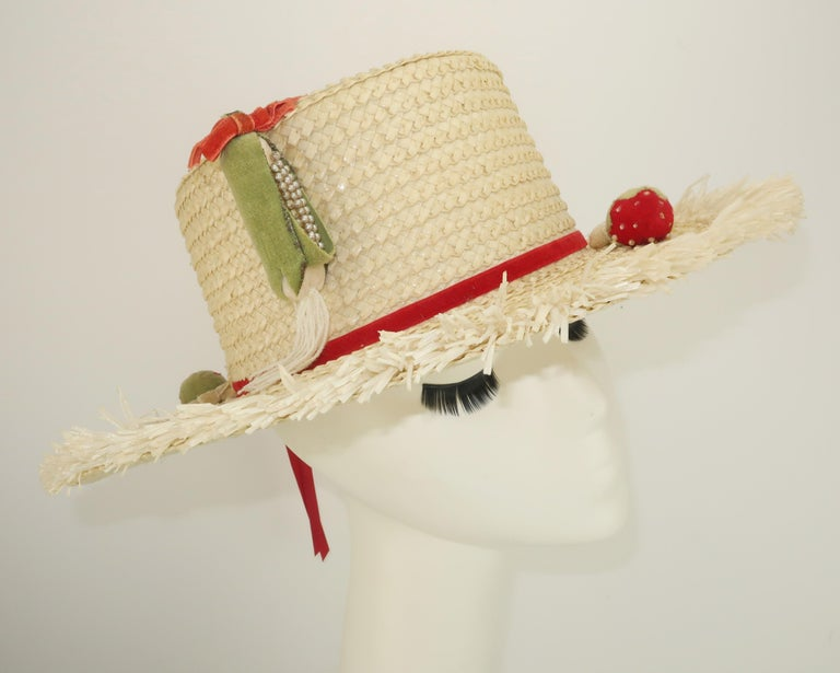 A blast from the 1950's Floridian past ... a vanilla white straw hat with a raffia trimmed brim and velvet decorations including strawberries and miniature corn cobs accented by pearl beads.  Novelty hats are a fun way to add a vintage touch to a