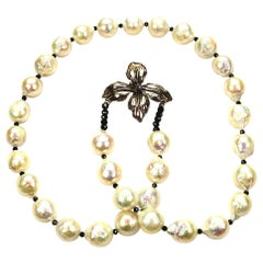 White Wrinkle Pearl Necklace with Sterling Silver Petal Motif Clasp